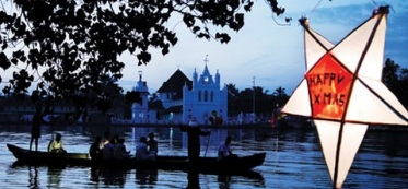 Santa waving while slowing going by a Church in the backwaters of Kerala